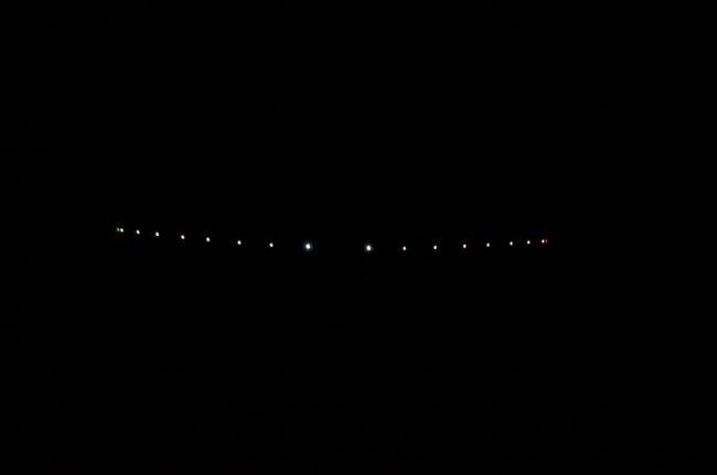 Solar Impulse 2 on short final, runway 32R, Moffett (KNUQ)